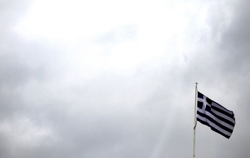 The Greek national flag above the parliament building in Athens on Feb. 16, 2012. Photographer: Simon Dawson/Bloomberg