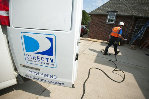 A DirectTV Group Inc. employee performs a satellite installation at a customer's home in Bixby, Oklahoma. Photographer: Paul Taggart/Bloomberg