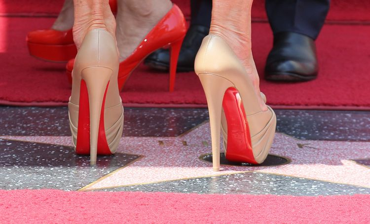 Louboutin Wins Appeal Over Saint Laurent Red-Soles Shoes - Bloomberg
