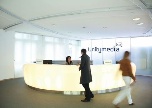 Employees Pass Through Unitymedia's Headquarters in Cologne