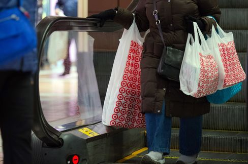 A Shopper Carries Bags From A Target Corp. Store