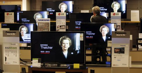 A customer stands and watches the news on television screens in a John Lewis Plc department store following the death of former premier Margaret Thatcher in London on April 8, 2013. Photographer: Simon Dawson/Bloomberg