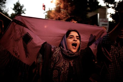 Woman in Purple Celebrates Rohani's Iranian Election