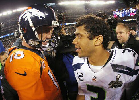 Denver Broncos' Peyton Manning &Seattle Seahawks' Russell Wilson