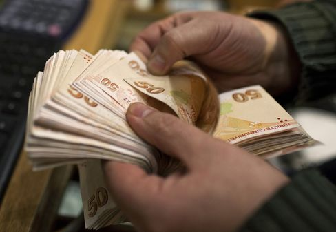 An Employee Counts Out 50 Turkish Lira Banknotes