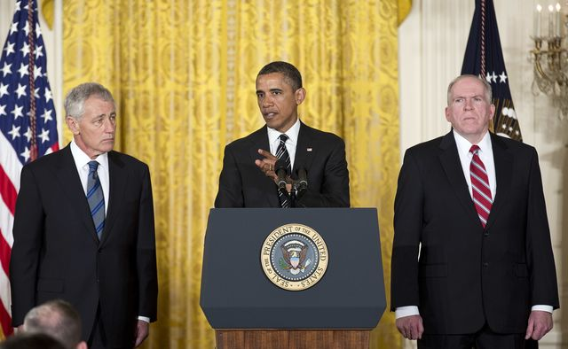 The president said CIA Director John Brennan, right, was staying. But for how long?