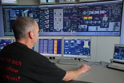An Employee Uses Software at a Power Plant