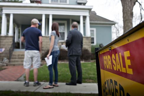 Potential Home Buyers Stand Outside a Previously Owned Home
