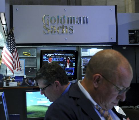 Traders work at the Goldman Sachs Group Inc. booth on the floor of the New York Stock Exchange in New York. Photographer: Peter Foley/Bloomberg