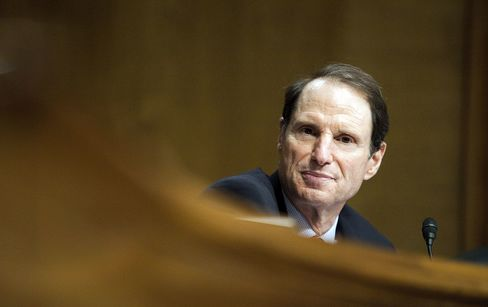 Baucus Exit Slows Tax Revamp as Wyden Rises to Advance Plan