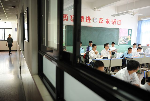 Schoolboys being taught in an all boys class at the government-run Shanghai Number Eight High School in Shanghai. Photograph: Peter Parks via AFP/Getty Images)