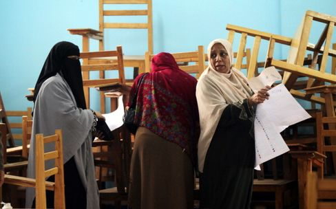 Egyptian women prepare to choose their candidates at a polling station in Giza, southwest Cairo, during the second round of parliamentary voting. Photographer: Khaled Desouki/AFP/Getty Images