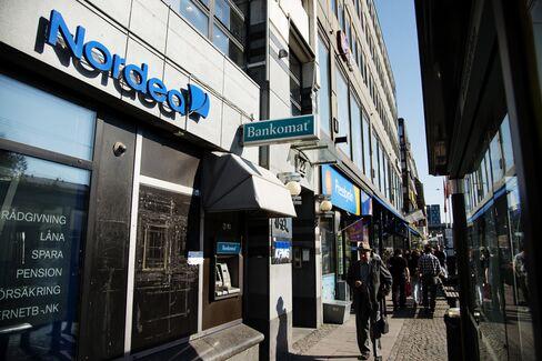 Pedestrians Pass a Nordea Bank AB Branch in Gothenburg