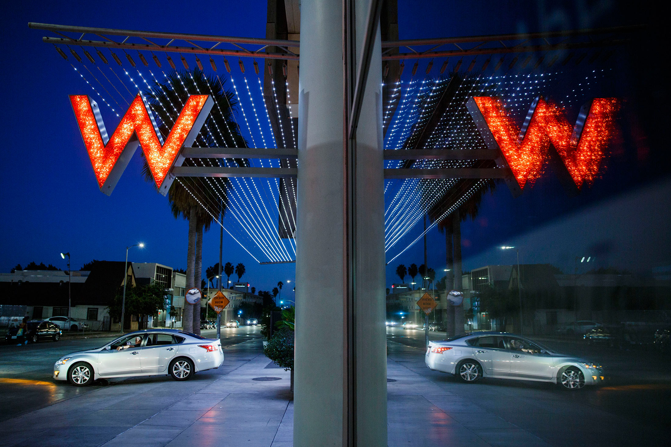 A car exits the driveway of Starwood Hotels & Resorts Worldwide Inc.'s W Hotel Hollywood in Hollywood, Calif.