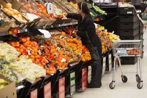 A Customer Shops for Fruit in a Supermarket in London
