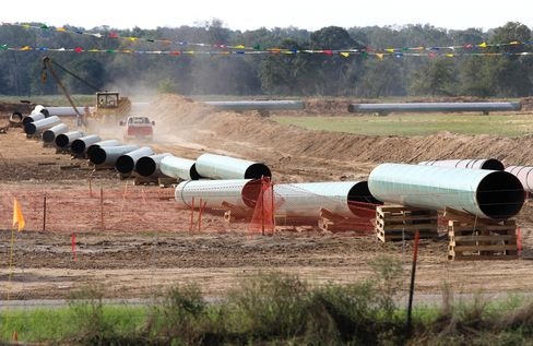 Large sections of pipe are shown in Sumner, Texas on Oct. 4, 2012. On Jan 22, 2014, TransCanada said in a statement on its website that it is delivering oil through the Gulf Coast portion of its proposed Keystone XL pipeline, from a hub in Cushing, Okla., to Houston-area refineries. Photographer: Tony Gutierrez/AP Photo