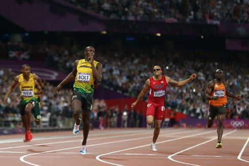 Usain Bolt of Jamaica crosses the finish line to win gold during the Men's 200m final. Photographer: Streeter Lecka/Getty Images