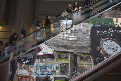 Hong Kong Growth Trails Estimates as City Cuts 2012 Outlook