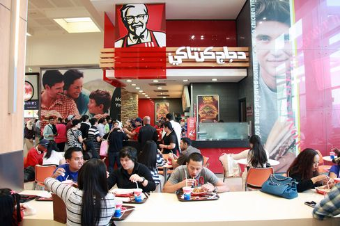 Popeyes Chicken Chases Suburbs as KFC Focuses Overseas