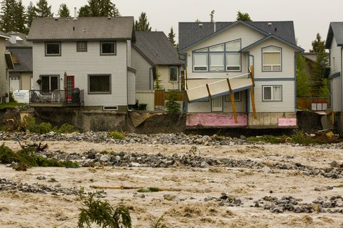 Calgary Floods Force 75,000 to Evacuate, Head Offices Shut