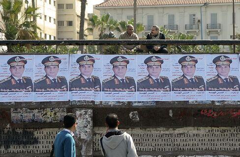 Posters of Abdel-Fattah al-Seesi Sit in Alexandria