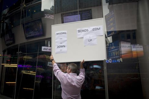 Peter Dorst, who works in operations at bonds.com, holds up a sign that reads