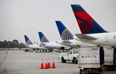 United Continental Alongside a Delta Airplane