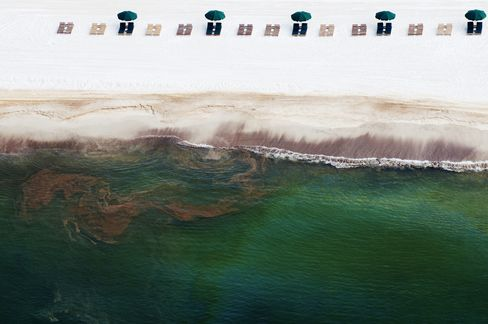 A file photo shows empty beach chairs resting on the sand as oil washes ashore in Orange Beach, Alabama, during June 2010. Photographer: Kari Goodnough/Bloomberg