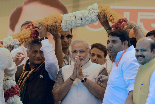 Narendra Modi could become the leader of an Indian electorate that is far more willing to hold its government accountable. Photographer: Raveendran/AFP/Getty Images
