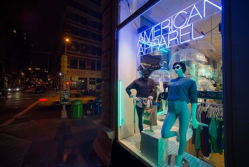 Mannequins Stand in the Window of an American Apparel Store