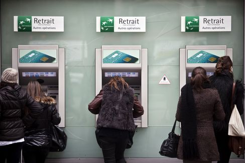 Customers use automated teller machines (ATM) at a BNP Paribas SA bank in Paris, France. Photographer: Balint Porneczi/Bloomberg