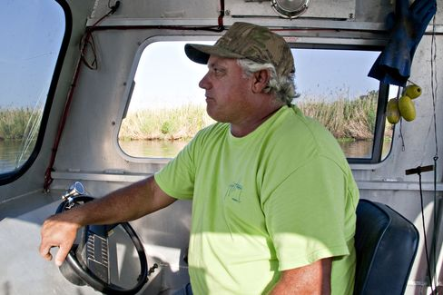 Claude Luke, a commercial crab fisherman who moonlights as a warden at the Harry Bourg preserve, worries that oil left over from the BP spill will wash into the marshlands. Photographer: Ken Wells/Bloomberg
