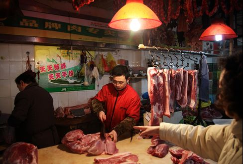Dead Hogs in River No Obstacle as China Pork Prices to Climb