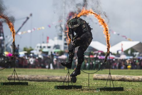 A member of the People's Liberation Army (PLA) jumps through a fire ring during an demonstration in Hong Kong.