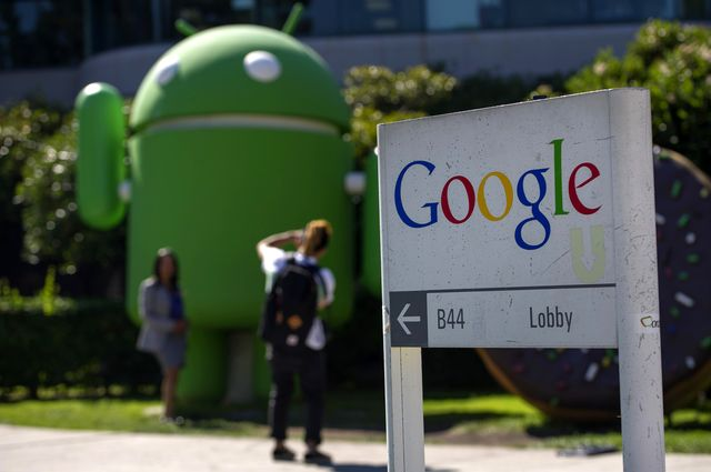 Google is playing catch-up to Apple in the most-valuable company rankings. Photographer: David Paul Morris/Bloomberg