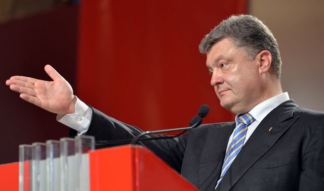 Look, there's a mess ahead for Petro Poroshenko to clean up. Photographer: Sergei Supinsky/AFP/Getty Images