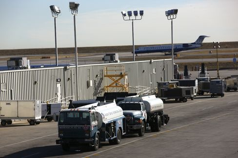 Parked Fuel Trucks Wait To Refuel Airplanes