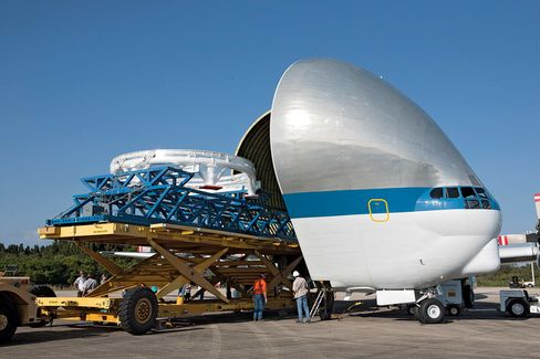 Loading portions of the Orion service module into a NASA transporter in Florida.