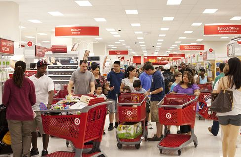 Shoppers push carts through the new Target Corp. store