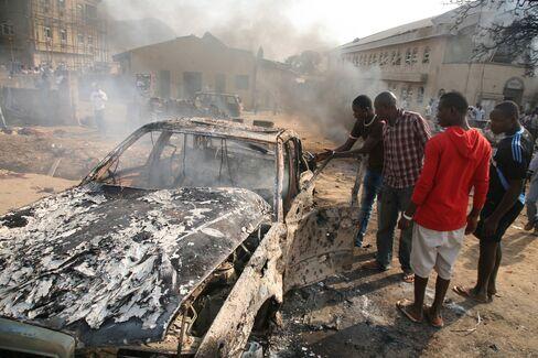 Nigeria Christmas Bombings Kill at Least 26 in Three Cities