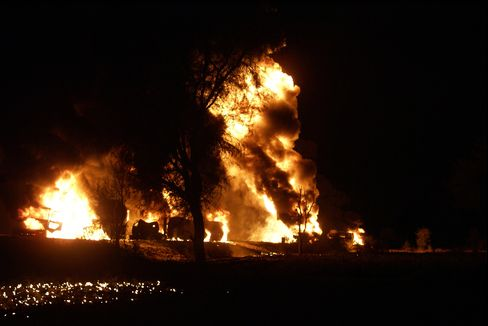 Flames Rise from Oil Tankers