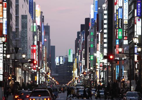 Buildings are illuminated in the Ginza district of Tokyo, Japan. Photographer: Tomohiro Ohsumi/Bloomberg News