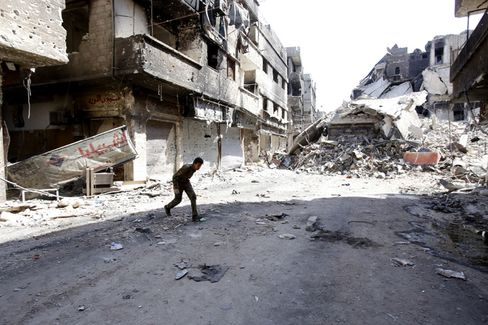 Fighter Crosses a Street in Damascus