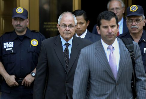 Peter Madoff, former Bernard L. Madoff Investment Securities LLC chief compliance officer, center, exits federal court in New York, on June 29, 2012. Photographer: Peter Foley/Bloomberg