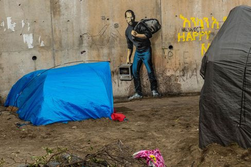 Street art representing Steve Jobs, by elusive British artist Banksy at the migrant camp known as the 'Jungle' in Calais, northern France.