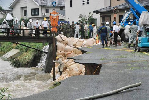Record Rains Leave 26 Dead, Six Missing in Southern Japan Floods