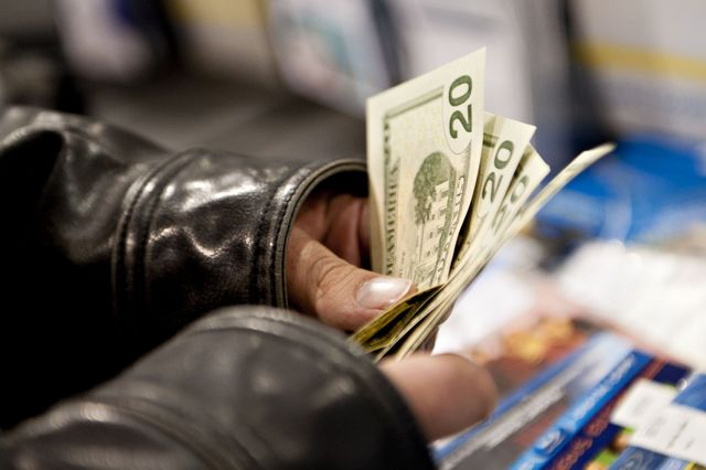 Who carries that kind of cash around anymore? Photographer: Daniel Acker/Bloomberg