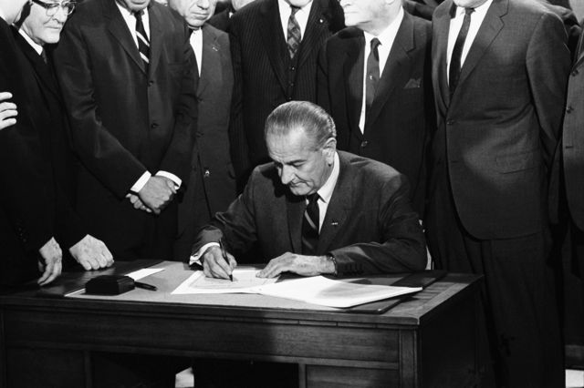 President Lyndon Johnson signs the Civil Rights Act of 1968 (also known as the Fair Housing Act). Photographer: Warren Leffler/Underwood Archives/Getty Images