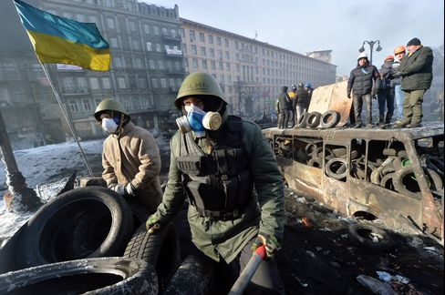 Protesters Stand on a Barricade in Kiev