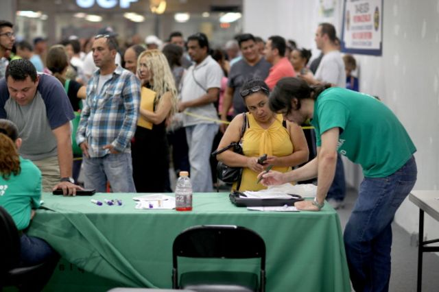 Look at these people signing up for health care. Better late than never. Photographer: Joe Raedle/Getty Images